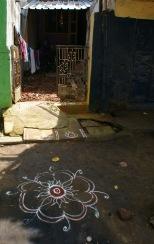 These chalk drawings are Rangoli, https://en.wikipedia.org/wiki/Rangoli