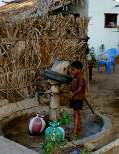 Boy fetching water from well