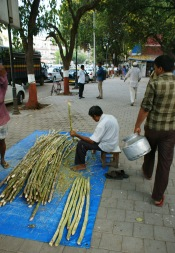 Even in the big city they drink sugar cane juice as is being prepped here