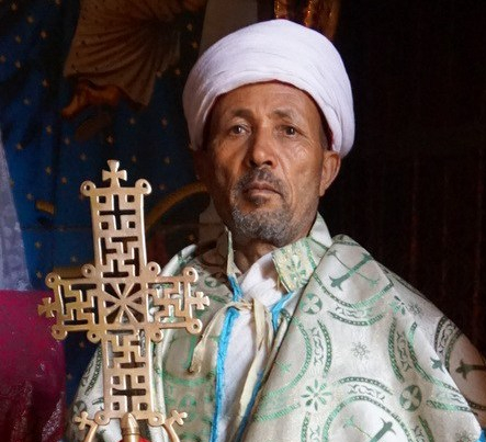 Priest posing with cross