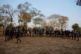 Men of the village doing dance with jumps