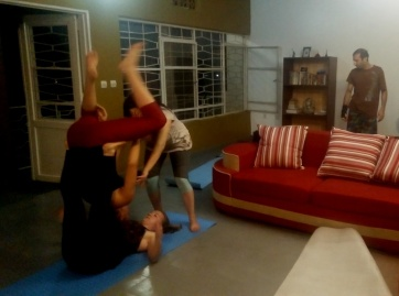 I've been getting into Acro Yoga and had the chance to go three times in Kigali to practice